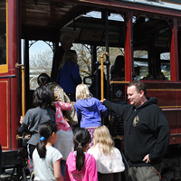 Students boarding the trolley for a Historic Transportation school program