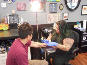 Tattoo artist Crystel Vasquez